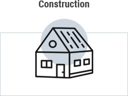 Grey circle clipart image of residential building with word construction above and rectangle around